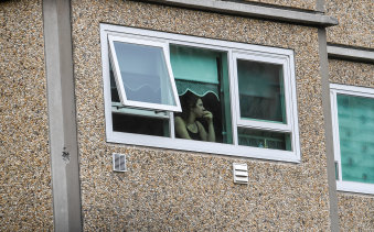 A resident stuck in their flat at a locked down tower in Flemington.