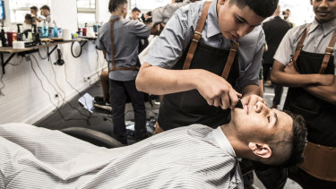Mahmoud Chanukah in the barber's chair at Granville Boys High.
