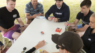 Victorian Police play a game of UNO after shift work on the borders.