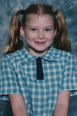 Bri in her primary school uniform in 1999, aged 8.