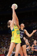 Caitlin Bassett of Australia is challenged by Karin Burger of New Zealand during the 2019 series.
