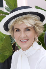 Julie Bishop jumps on the 'frostume' trend in Christie Nicolaides earrings on Derby Day.