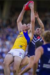 Good grab: West Coast's Jeremy McGovern marks in front of Fremantle's Hayden Ballantyne.