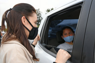 New Zealand Prime Minister Jacinda Ardern speaks to people who have been vaccinated at Te Taiwhenua o Heretaunga drive through vaccination centre on October 08, 2021 in Hastings, New Zealand.