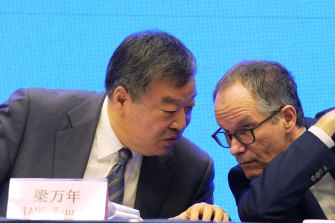 Only two weeks to conduct study: Peter Ben Embarek, of the World Health Organisation team, right, chats with his Chinese counterpart Liang Wannian during a WHO-China Joint Study Press Conference.