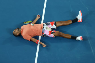 Work rate: Kyrgios lies on the court after losing a point to Nadal.