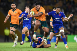 Replacement prop Taniela Tupou makes a ferocious charge late in the match.