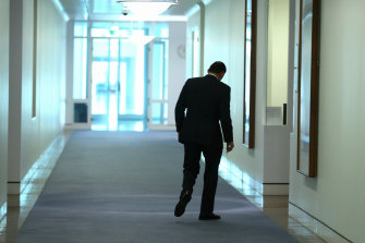 Tony Abbott walks back to his office at Parliament House after providing an update to the media in the wake of the MH17 crash.