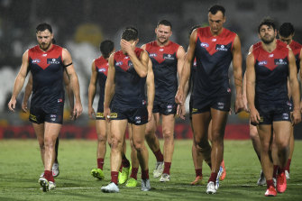 Despair: The Demons walk off the field after their round 16 loss to Fremantle.