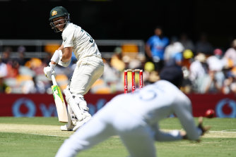 David Warner watches on as Rohit Sharma shapes for the catch in Brisbane.