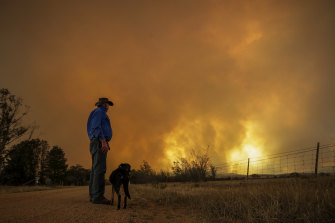 Bombay resident Les Hart watches the North Black Range bushfire approach.