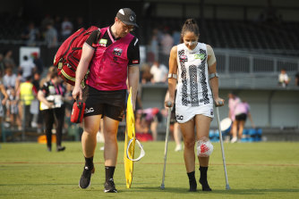 The Magpies' Jordan Membrey on crutches after injuring her knee against Melbourne on Sunday.