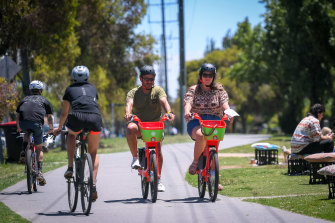 Jeremy Pereira and partner Gianna Donnini give the Lime bikes a go in Brunswick on Tuesday.