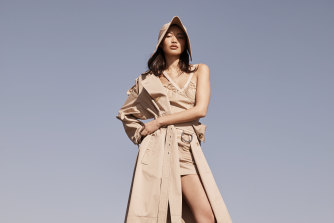 "Burberry trench and skirt, $3950, corset top, $2090, and bonnet cap, $740. Bottega Veneta ""Tire"" boots, $1590."