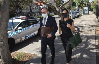 Eyebrow queen Kristin Fisher arrives at Waverley Local Court on Wednesday with her lawyer Michael Bowe.