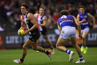 Saint Jake Steele evades Marcus Bontempelli during last year's Marvel Stadium clash.