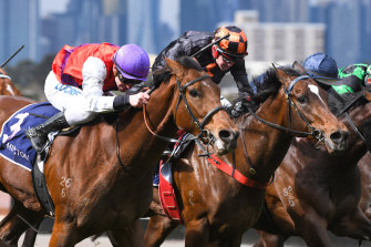 Ben Melham riding Heirborn (left) to victory in Race 2.