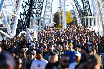 Fans make their over the Matagarup Bridge to Optus Stadium during the Dreamtime match earlier this year.