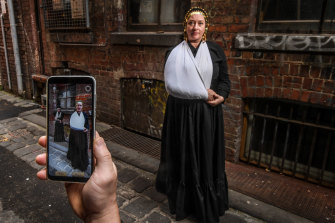 Emma Ramsay, co-creator of the Eastern Market Murder mobile phone app, in period costume at a key location from the case, and the game.