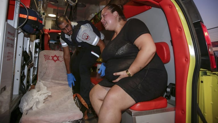 An injured person is treated after a missile from Gaza Strip hit the town of Sderot.