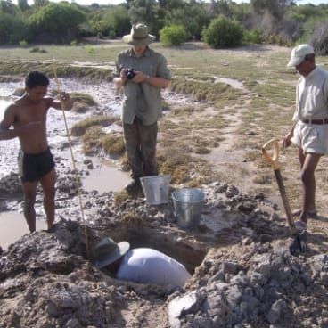 Atholl Anderson (front) excavates in Madagascar with Aaron Camens from Flinders University (back centre) Ramilisonina from the Muse ́e d'Art et d'Archae ́ologie (right) and a local worker.