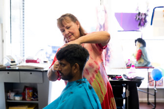 Diane White with a client, Joseph John, in her hairdressing salon in Walgett.