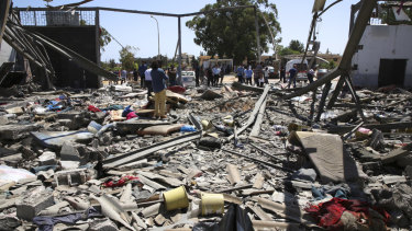 Debris covers the ground after air strikes at a detention centre in Tajoura, east of Tripoli in Libya.