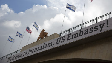 A sign on a bridge leading to the US Embassy ahead of Monday's official opening in Jerusalem.
