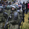 Police fire warning shots as thousands gather in Minsk