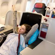 Business class generic. Woman sleeping on plane
