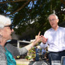 Malcolm Turnbull berated by voters in byelection pub visit
