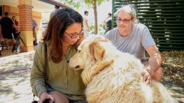 Tara and Anton Minchin with their dog Bear.