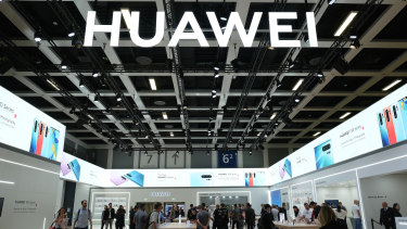 Visitors check out new Huawei smartphones in Berlin, Germany.