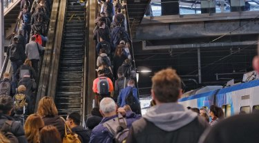Commuters slowly making their way up the escalators at Southern Cross Station on Tuesday morning. One escalator is broken and may not be fixed for months.