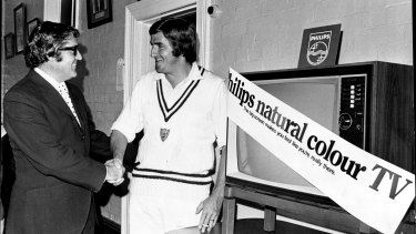 Cricketer Gary Gilmour accepts a colour TV set from Philips consumer manager, Mr Bruce Rowan.