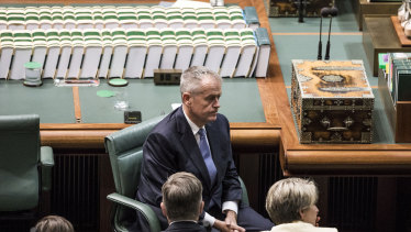 Opposition leader Bill Shorten listens as Treasurer Josh Frydenberg hands down the budget in the House of Representatives at Parliament House in Canberra on April 2, 2019.