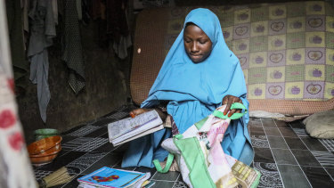 Masauda Umar, 20, who hid under her bed and managed to escape when gunmen abducted more than 300 girls from her boarding school.