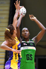 Jhaniele Fowler of the Fever (right) shoots as Geva Mentor of the Lightning (left) defends.