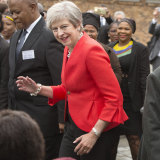 British Prime Minister Theresa dances with children during a visit to the ID Mkhize High School in Gugulethu, Cape Town, South Africa.