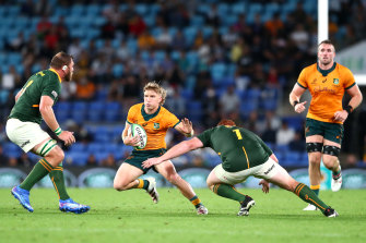 Tate McDermott stepping in attack against the Springboks on the Gold Coast.