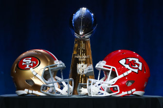 The Vince Lombardi Trophy with San Francisco and Kansas City helmets.