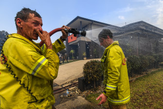 An MFB fireman cools down.