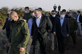 Secretary of State Mike Pompeo, centre, arrives on Mount Bental in the Israeli-controlled Golan Heights.