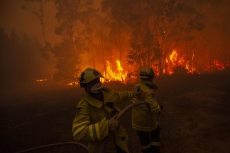 Local firefighters battle a fire at Mangrove Mountain in NSW on January 5. Australia has also called in overseas firefighters and experts to battle the mammoth blazes here.
