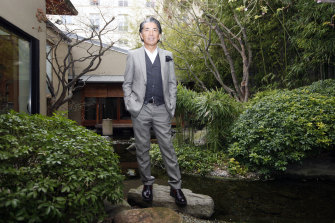 Japanese fashion designer Kenzo Takada, pictured outside his Paris house in 2009, has died of COVID-19.