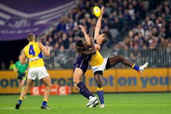 Top flight: West Coast's Nic Naitanui goes up against Fremantle's Aaron Sandilands.