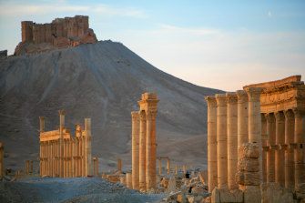 People visit the impressive Roman remains of Palmyra before the war. The city's treasured ruins were destroyed by Islamic State.