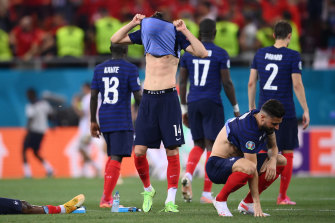 France players react after Kylian Mbappe's decisive penalty miss.