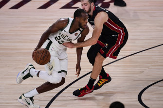Khris Middleton had 21 of his 36 points in the third quarter before launching a crucial three in overtime.