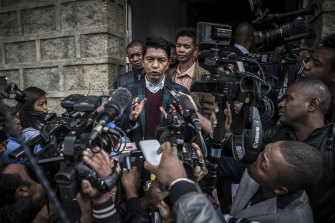 President Andry Rajoelina of Madagascar speaks to reporters after voting during legislative elections in Antananarivo, Madagascar, in late May 2019